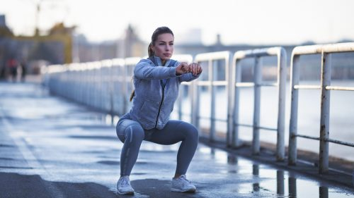 young woman exercising outdoors royalty free image 649970260 1560430799
